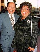 "The stars of the popular television series ""The Jeffersons"" Sherman Hemsley and Isabel Sanford pose as they arrive for the premiere screening of the new television special ""50 Years of Television"" in Los Angeles in this April 16, 1997 file photo"